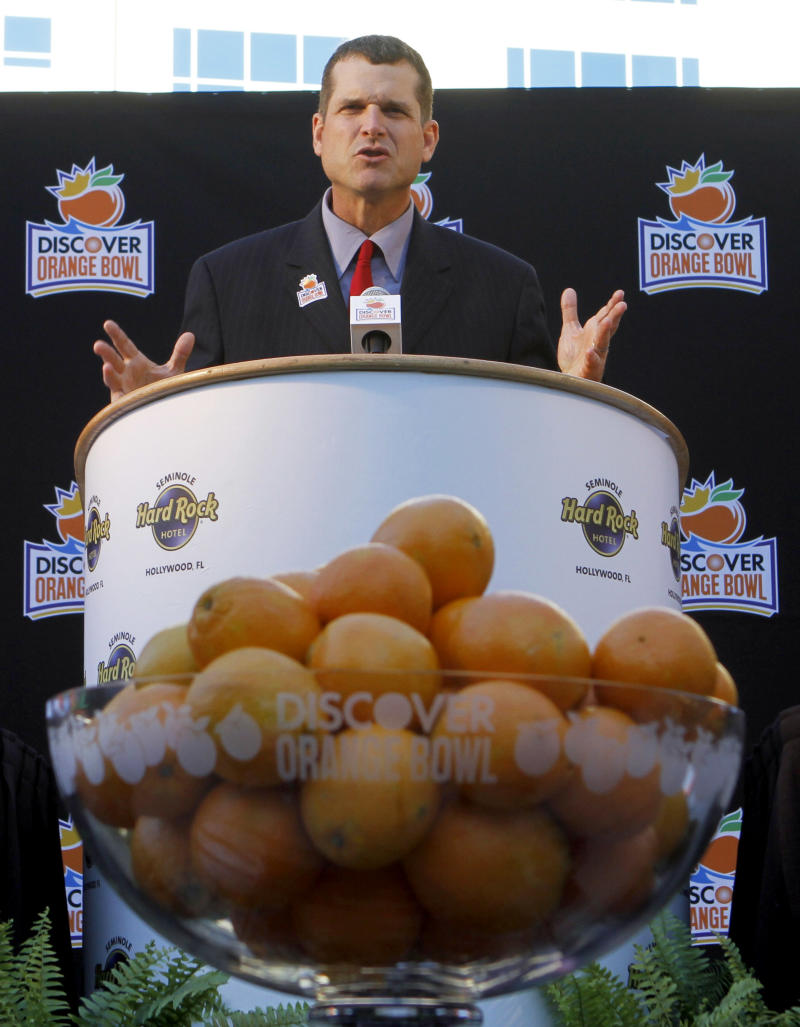 Stanford coach Jim Harbaugh addresses the media during a news conference in Hollywood, Fla., Wednesday, Dec. 8,  2010. Stanford is scheduled play against Virginia Tech in the Orange Bowl NCAA college football game on Jan. 3, 2011. (AP Photo/Alan Diaz)