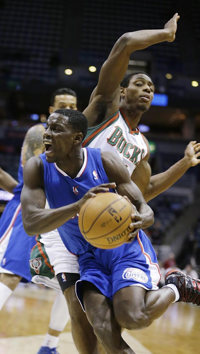 Los Angeles Clippers' Darren Collison drives against Milwaukee Bucks' Brandon Knight right, during the first half of an NBA basketball game, Monday, Jan. 27, 2014, in Milwaukee. (AP Photo/Jeffrey Phelps)