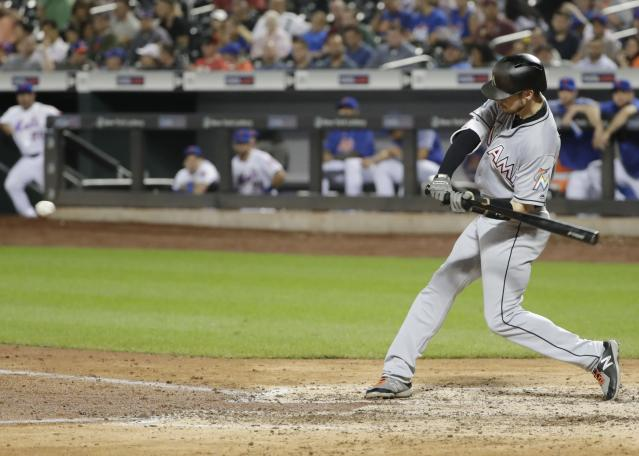 Miami Marlins' JT Riddle (10) hits a home run during the eighth inning of a baseball game against the New York Mets Tuesday, Sept. 11, 2018, in New York. (AP Photo/Frank Franklin II)