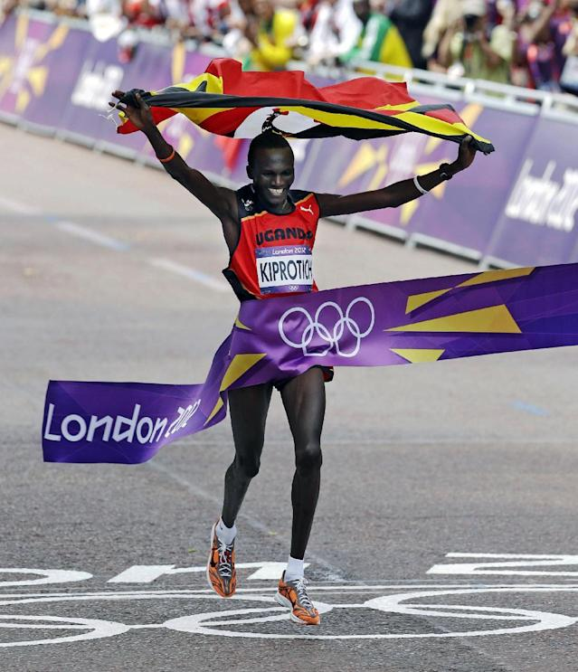 Gold-medalist Stephen Kiprotich of Uganda finishes the men's marathon at the 2012 Summer Olympics, Sunday, Aug. 12, 2012, in London. (AP Photo/Mike Groll)