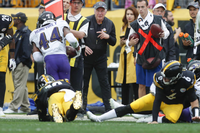 Baltimore Ravens cornerback Marlon Humphrey (44) runs with the ball after recovering a fumble by Pittsburgh Steelers wide receiver JuJu Smith-Schuster (19) during overtime of an NFL football game, Sunday, Oct. 6, 2019, in Pittsburgh. Steelers quarterback Devlin Hodges (6) is at right. (AP Photo/Don Wright)
