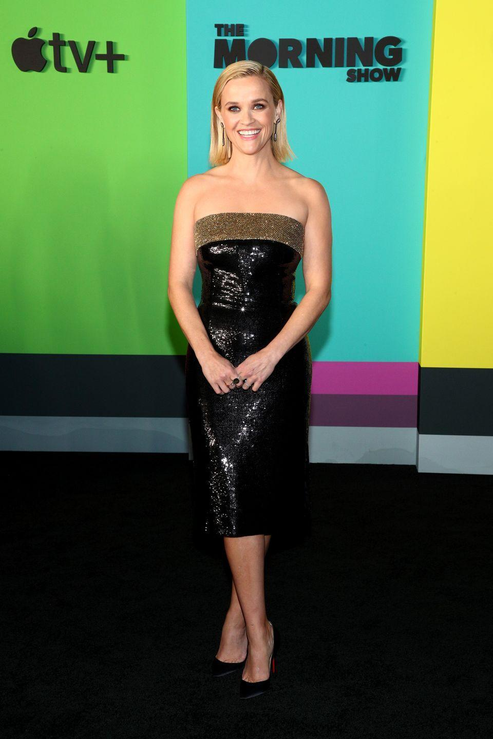 <p>For the world premiere of <em>The Morning Show</em>, she opted for a black and gold sequined Celine dress. </p>