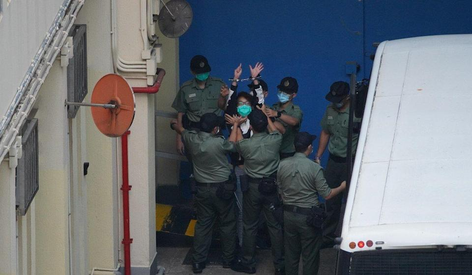 Civil Human Rights Front convenor Figo Chan gestures as he is remanded in custody earlier this year. Photo: Winson Wong