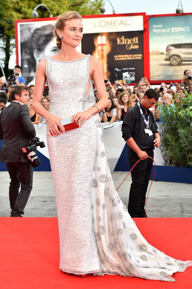 <p>Diane Kruger, a fashion industry darling if there ever was one, channeled old world Hollywood glam at the opening ceremony in an embellished silver Prada gown with a cascading train. (Getty Images)<br /></p>