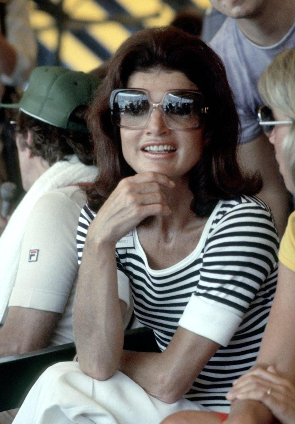 <p>Wearing her signature over-sized sunglasses and a striped shirt at the annual RFK Pro-Celebrity tennis tournament. </p>
