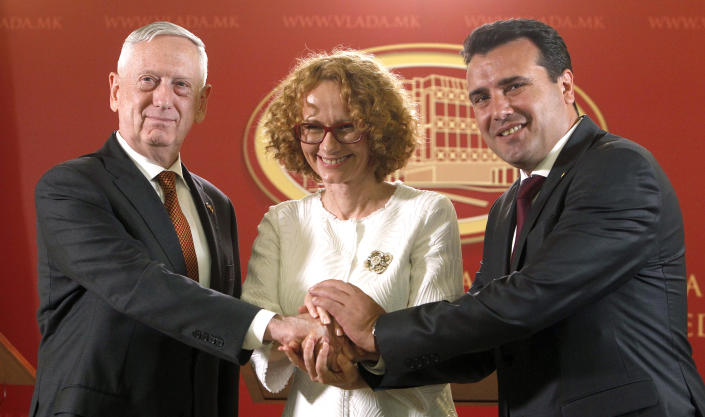 U.S. Defense Secretary James Mattis, left, Macedonian Prime Minister Zoran Zaev, right and Macedonian Defense Minister Radmila Sekerinska, center, shake hands while posing for the media, after their meeting at the government building in Skopje, Macedonia, Monday, Sept. 17, 2018. Mattis arrived in Macedonia Monday, condemning Russian efforts to use its money and influence to build opposition to an upcoming vote that could pave the way for the country to join NATO, a move Moscow opposes. (AP Photo/Boris Grdanoski)