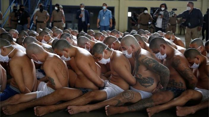 Gang members wait outside their cells during a search at the Izalco jail during a media tour, in Izalco, El Salvador September 4, 2020.