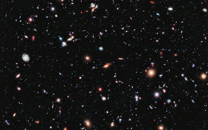 A new, improved portrait of Hubble's deepest-ever view of the universe, called the eXtreme Deep Field, or XDF, which shows a small area of space in the constellation Fornax, created using Hubble Space Telescope data from 2003 and 2004 - Reuters