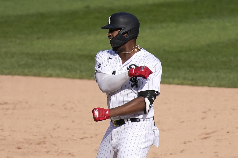 Chicago White Sox's Eloy Jimenez reacts on second after hitting an RBI double off Minnesota Twins relief pitcher Sergio Romo during the seventh inning of a baseball game, Thursday, Sept. 17, 2020, in Chicago. Yolmer Sanchez scored on the play. (AP Photo/Charles Rex Arbogast)