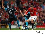 Premier League action as between Manchester United and Arsenal