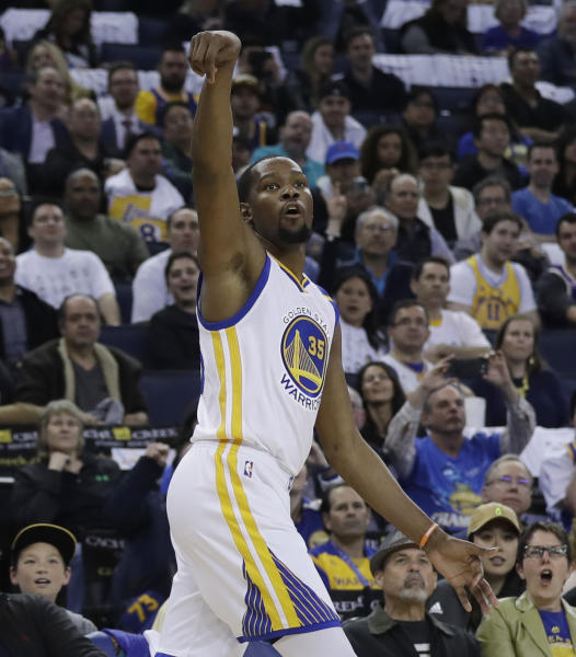 FILE - In this April 12, 2017, file photo, Golden State Warriors' Kevin Durant follows through on a 3-point basket during the second half of the team's NBA basketball game against the Los Angeles Lakers, in Oakland, Calif. Nobody wanted to miss this impromptu, incredible shooting display by two of the world's very best: Stephen Curry and Kevin Durant took turns firing 3-pointer after 3-pointer, some 200 of them total, all while their coaches-turned-rebounders kept careful count of their makes and misses in an entertaining post-practice show.(AP Photo/Marcio Jose Sanchez)