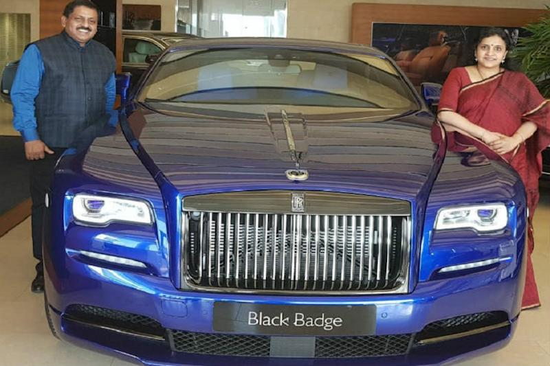 Sohan Roy and wife with Rolls Royce Cullinan. Sohan Roy )