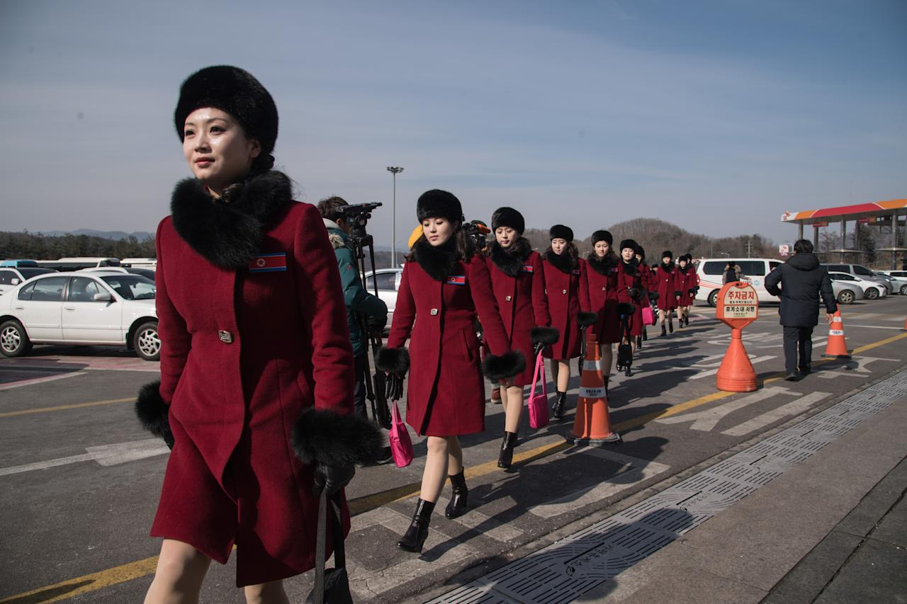 <p>North Korean cheerleaders arrive at a rest stop as their bus convoy carrying a 280-member delegation on its way to the 2018 Pyeongchang winter Olympic games, makes its way past Gapyeong on February 7, 2018. </p>