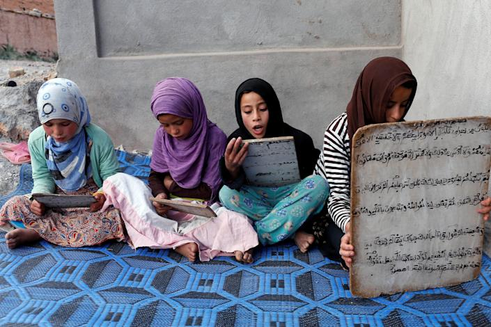Moroccan girls read the Koran in a madrasa, or religious school, during the Muslim holy month of Ramadan in a village in Tinghir, Morocco June 11, 2017. Picture taken June 11, 2017. REUTERS/Youssef Boudlal