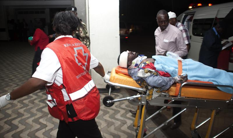 An injured Kenyan is wheeled into Kenyatta National Hospital in Nairobi, Kenya, Monday March 31, 2014, after an explosion in downtown Nairobi killed at least five people. The National Disaster Operation Center said on Twitter that explosions had occurred Monday evening in a neighborhood known for its large Somali population, and the agency said five people were killed and several injured without saying what caused the blasts. (AP Photo/Sayyid Azim)