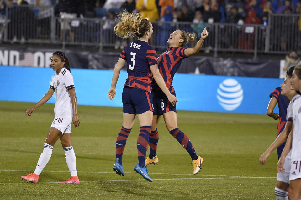 United States' Samantha Mewis, left, celebrates her goal with teammate United States' Kristie Mewis during the first half of an international friendly soccer match against Mexico, Thursday, July 1, 2021, in East Hartford, Conn. (AP Photo/Jessica Hill)