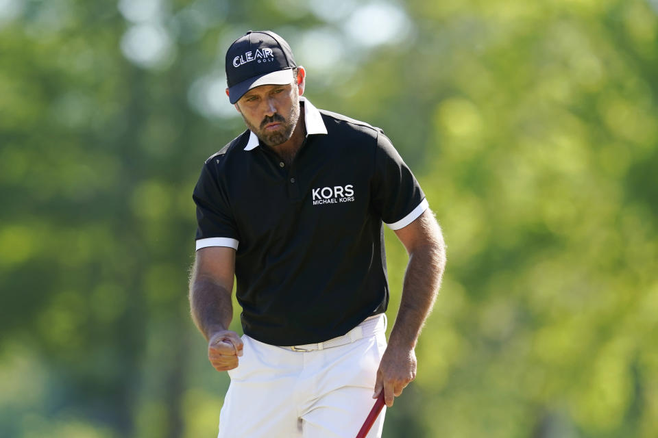 Charl Schwartzel, of South Africa, reacts after making his putt on the 15th green during the final round of the PGA Zurich Classic golf tournament at TPC Louisiana in Avondale, La., Sunday, April 25, 2021. (AP Photo/Gerald Herbert)