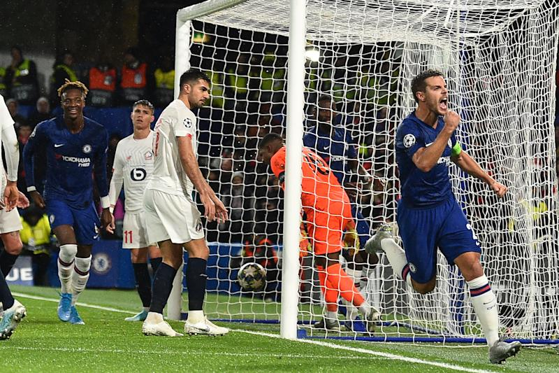 Chelsea's Spanish defender Cesar Azpilicueta (R) celebrates after scoring their second goal during the UEFA Champion's League Group H football match between Chelsea and Lille at Stamford Bridge in London on December 10, 2019. (Photo by Glyn KIRK / AFP) (Photo by GLYN KIRK/AFP via Getty Images)