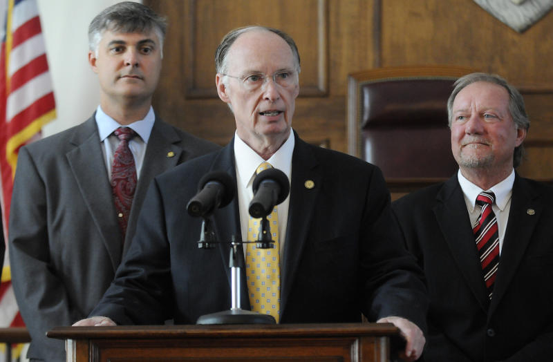 Alabama Gov. Robert Bentley sAlabama Gov. Robert Bentley is flanked by Sen. Scott Beason, R-Gardendale, left, and Micky Hammon, R-Decatur, right, as he speaks before signing into law what critics and supporters are calling the strongest bill in the nation cracking down on illegal immigration, on Thursday June 9, 2011 at the state Capitol in Montgomery, Ala. The bill  allows police to arrest anyone suspected of being an illegal immigrant if they're stopped for any other reason. It also requires public schools to determine students' immigration status and makes it a crime to knowingly give an illegal immigrant a ride. (AP Photo/Montgomery Advertiser, Mickey Welsh)