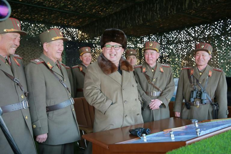 Picture released by North Korea's official Korean Central News Agency shows North Korean leader Kim Jong-Un (C) inspecting an artillery drill at an undisclosed location