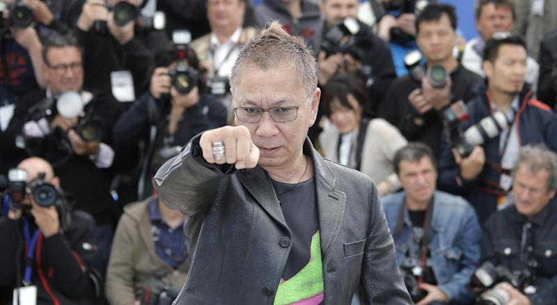 Director Takashi Miike gestures during a photo call for the film Shield of Straw at the 66th international film festival, in Cannes, southern France, Monday, May 20, 2013. (AP Photo/Francois Mori)