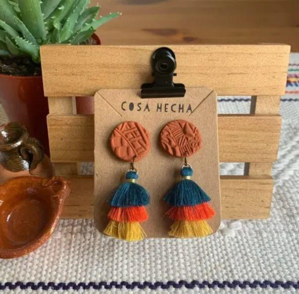 """<a href=""""https://fave.co/3c3IANL"""" target=""""_blank"""" rel=""""nofollow noopener noreferrer"""">Cosa Hecha</a>is a Latinx-owned Etsy shop based in Ann Arbor, Michigan, that specializes in handmade clay jewelry inspired by Mexican pottery with a variety of tassel earrings and clay studs. Shop these<a href=""""https://fave.co/32CdhGL"""" target=""""_blank"""" rel=""""nofollow noopener noreferrer"""">Textured Pelucitas Earrings in color for $12</a>at<a href=""""https://fave.co/3c3IANL"""" target=""""_blank"""" rel=""""nofollow noopener noreferrer"""">Cosa Hecha on Etsy.</a>"""