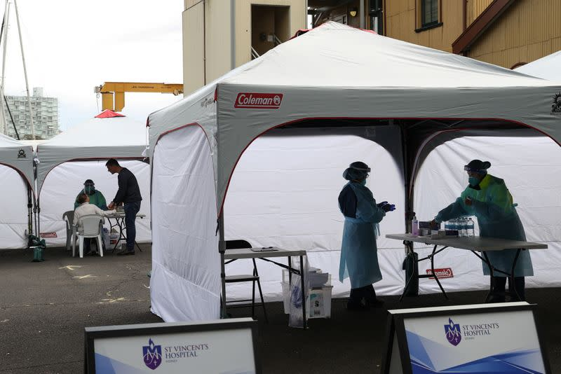 Medical workers and members of the public are seen at a COVID-19 pop-up testing centre in Sydney