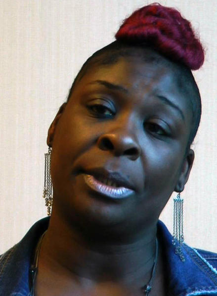 """In this still image taken from video, April Pipkins, mother of the late Emantic """"EJ"""" Bradford Jr., speaks during an interview in Birmingham, Ala., on Tuesday, Nov. 27, 2018. Bradford was shot to death by a police officer in a shopping mall on Thanksgiving night, and Pipkins said she believes her son would still be alive had he been white. (AP Photo/Jay Reeves)"""
