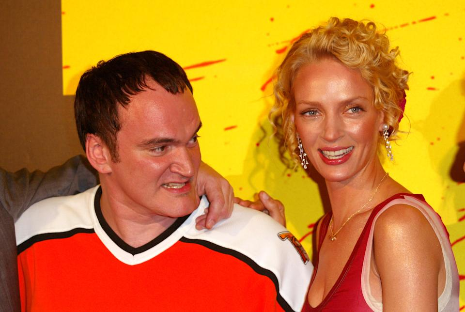 """Quentin Tarantino and Uma Thurman during """"Kill Bill Volume 1"""" Premiere in Paris at Grand Rex Theater in Paris, France. (Photo by Tony Barson/WireImage)"""