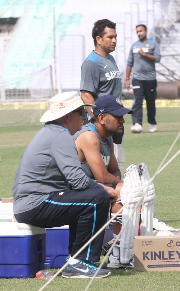 Indian Cricketers Sachin Tendulkar and Mahendra Singh Dhoni during a practice session ahead of test match between India and West Indies starting on Nov 6 at Eden Gardens in Kolkata on Nov.5, 2013. (Photo: IANS)