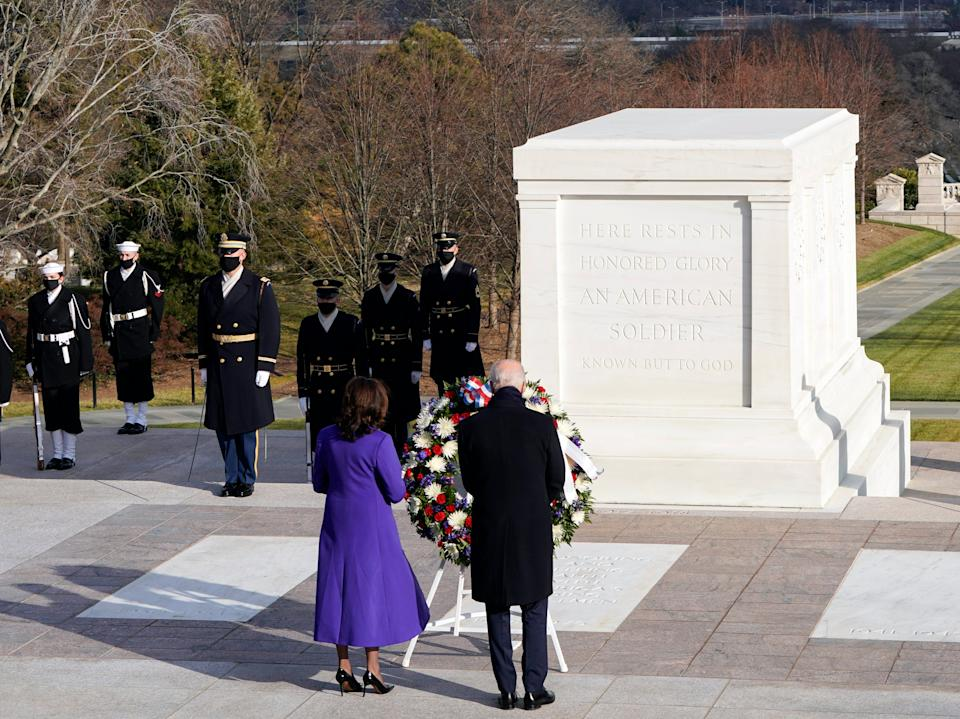 Joe Biden and Kamala Harris lay a wreath at the Tomb of the Unknown Soldier at the Arlington National Cemetery following the inauguration ceremonyAP