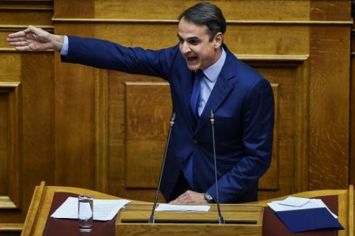 Leader of Greece's main opposition New Democracy party Kyriakos Mitsotakis gestures in parliament ahead of a weekend censure vote against the government in a bid to block a proposed name deal with Macedonia