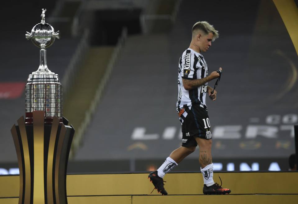 Soteldo of Brazil's Santos walks past the Copa Libertadores trophy after his team lost against Brazil's Palmeiras during a Copa Libertadores final soccer match at the Maracana stadium in Rio de Janeiro, Brazil, Saturday, Jan. 30, 2021. Palmeiras won 1-0. (Mauro Pimentel/Pool via AP)