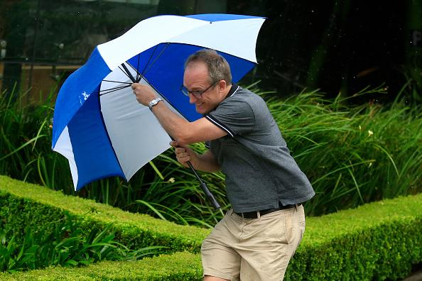 A man struggles with the wind and rain in Sydney, Australia.