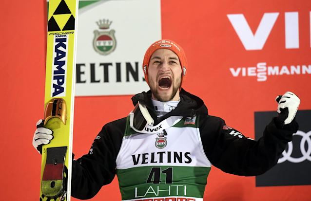 Lahti Ski Games - FIS Nordic World Cup - Men's Ski Jumping - Lahti, Finland - March 4, 2018. Markus Eisenbichler of Germany celebrates on the podium. LEHTIKUVA/Markku Ulander via REUTERS ATTENTION EDITORS - THIS IMAGE WAS PROVIDED BY A THIRD PARTY. NO THIRD PARTY SALES. NOT FOR USE BY REUTERS THIRD PARTY DISTRIBUTORS. FINLAND OUT. NO COMMERCIAL OR EDITORIAL SALES IN FINLAND.