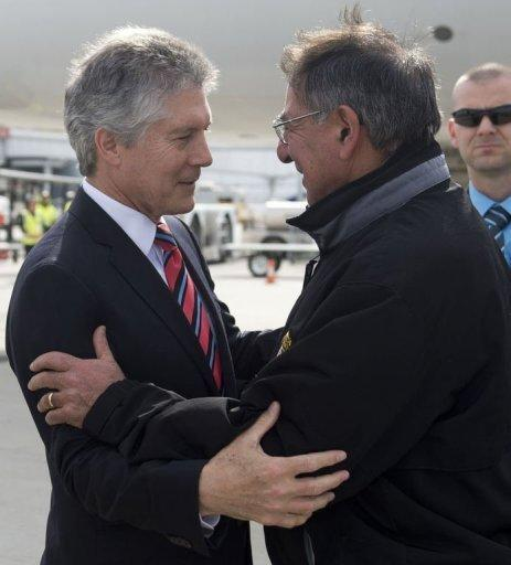 Australian Minister of Defense Stephen Smith (L) greets US Secretary of Defense Leon Panetta as he arrives at Perth International Airport in Perth. Panetta told reporters before flying into Perth that the Americans were ready to follow through on a plan to pivot to the Pacific despite crises in the Middle East and fiscal strains at home