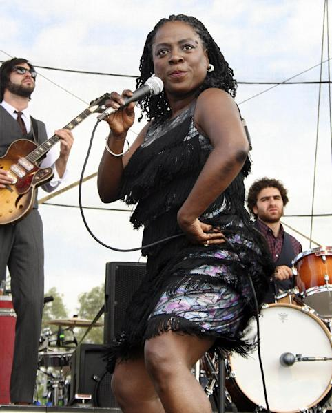 FILE - In this June 14, 2008 file photo, Sharon Jones and the Dap-Kings perform at the Bonnaroo music festival in Manchester, Tenn. Jones, a big-voiced soul singer who performed with high energy onstage has died at age 60 in New York, after battling pancreatic cancer. Her representative Judy Miller Silverman says she died Friday, Nov. 18, 2016, at a Cooperstown hospital surrounded by her band, the Dap-Kings. (AP Photo/Jake Coyle, File)