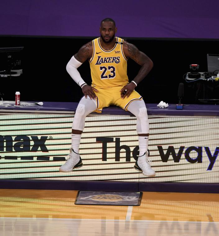LeBron James #23 of the Los Angeles Lakers waits to enter the game against the Phoenix Suns in the second half of game six of the Western Conference First Round NBA Playoff basketball game at the Staples Center in Los Angeles on Thursday, June 3, 2021. (Keith Birmingham/The Orange County Register via AP)