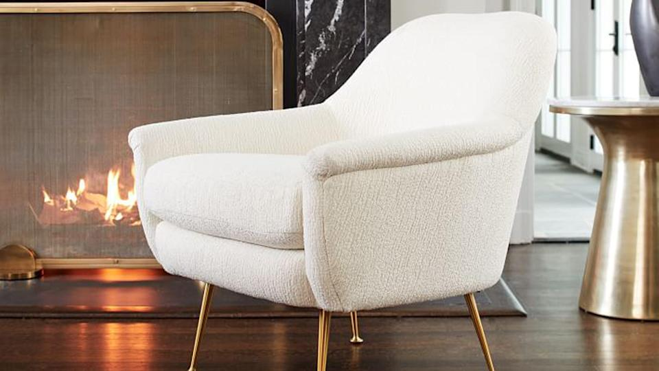 Shoppers can get dozens of stylish furniture pieces, like this Phoebe Chair, for an extra 25% off at this West Elm clearance event.