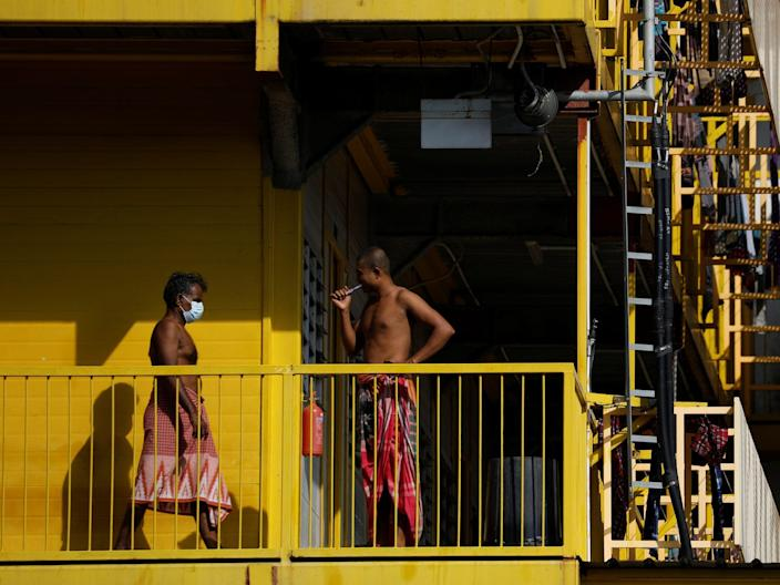 <br>Migrant workers are pictured outside their rooms at a dormitory in Singapore on April 21, 2020.