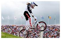 <p>Long pants, long sleeves, and a mask keep BMX bikers at the top of their game.</p><p><i>(Photo: Getty Images)</i><br></p>
