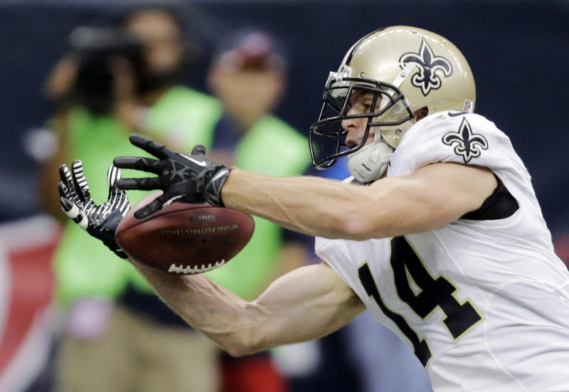New Orleans Saints wide receiver Andy Tanner (14) makes a 15-yard touchdown reception against the Houston Texans during the second half of a preseason NFL football game on Sunday, Aug. 25, 2013, in Houston. (AP Photo/Eric Gay)