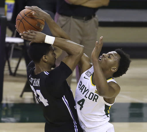 Baylor guard L.J. Cryer (4) tries to strip the ball from Central Arkansas forward Samson George (23) in the second half of an NCAA college basketball game, Tuesday, Dec. 29, 2020, in Waco, Texas. (AP Photo/ Jerry Larson)