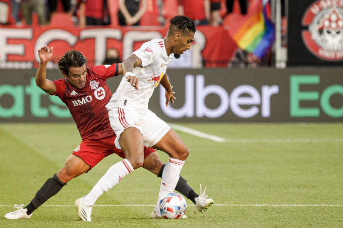 New York Red Bulls forward Fabio, right, is defended by Toronto FC forward Tsubasa Endoh during the first half of an MLS soccer match Wednesday, July 21, 2021, in Toronto. (Chris Katsarov/The Canadian Press via AP)