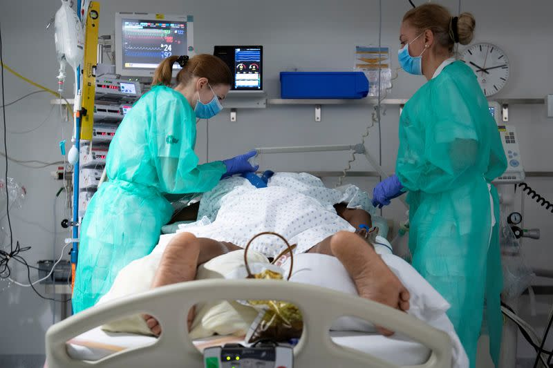 FILE PHOTO: Staff treat a patient in the intensive care unit at the CHUV in Lausanne