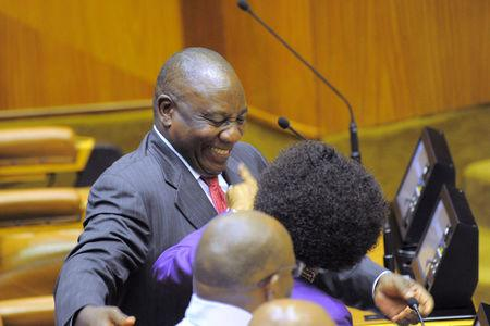 Ramaphosa enjoys the moment of applause as he is elected President of South Africa at the parliament in Cape Town