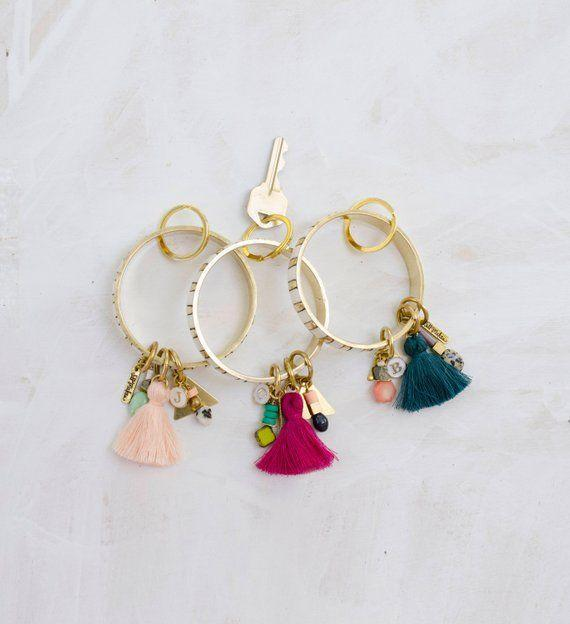 """<p><strong>JillMakes</strong></p><p>etsy.com</p><p><strong>$25.00</strong></p><p><a href=""""https://go.redirectingat.com?id=74968X1596630&url=https%3A%2F%2Fwww.etsy.com%2Flisting%2F546437146%2Fpersonalized-keyring-wearable-keychain&sref=https%3A%2F%2Fwww.countryliving.com%2Fshopping%2Fgifts%2Fg2127%2Fcheap-christmas-gifts%2F"""" rel=""""nofollow noopener"""" target=""""_blank"""" data-ylk=""""slk:Shop Now"""" class=""""link rapid-noclick-resp"""">Shop Now</a></p><p>Perfect for a stylish friend, these bright designs will make it that much easier to find your keys.</p>"""