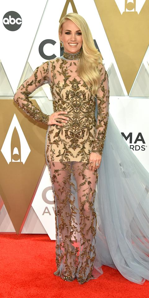 <p>At the 53rd Annual CMA Awards, Carrie Underwood wore a Yas Couture gown, Jared Lehr and Loree Rodkin jewelry, and Jimmy Choo heels.</p>