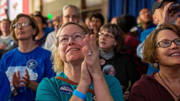 PHOTO: Supporters of democratic presidential candidate Vermont Sen. Bernie Sanders wait for results to come in at his caucus night watch party on Feb. 3, 2020, in Des Moines, Iowa. (Kerem Yucel/AFP via Getty Images)