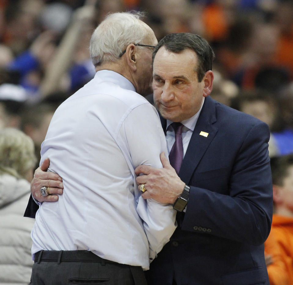 Duke coach Mike Krzyzewski, right, embraces Syracuse coach Jim Boeheim at the end of an NCAA college basketball game in Syracuse, N.Y., Saturday, Feb. 23, 2019. Duke won 75-65. (AP Photo/Nick Lisi)